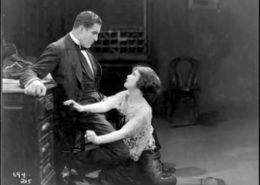 """Screenshot from 1925 film adaptation of """"Salome of the Tenements"""" directed by Sidney Olcott, starring Jetta Goudal as Sonya & Godfrey Tearle as John."""